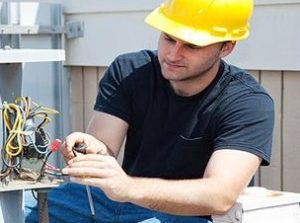 technician fixing wiring