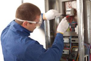 Technician rewiring panel