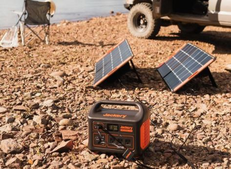 Portable solar generator by Jackery on campsite